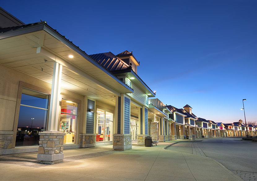 Retail strip center at dusk
